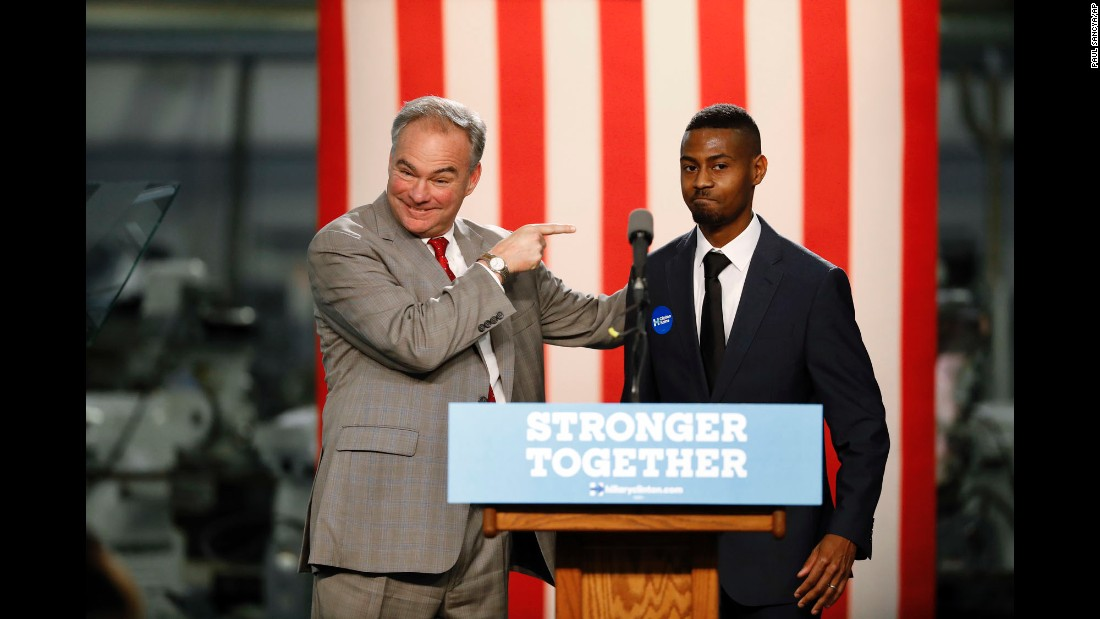 U.S. Sen. Tim Kaine, Hillary Clinton's running mate on the Democratic ticket, points to Jejuan Toney, who introduced Kaine during a campaign stop in Detroit on Tuesday, October 18.