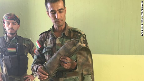 Captain Chilhan Sadk with an ISIS-made suicide belt he diffused.