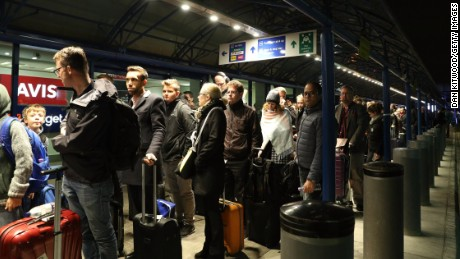 Passengers queued outside London City Airport after it was evacuated Friday.