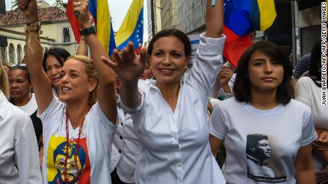 (L-R)Diana D'Agostino wife of The president of the Venezuelan National Assembly, Henry Ramos Allup , Lilian Tintori, wife of Venezuelan jailed opposition leader Leopoldo Lopez ,Venezuelan opposition ex-congresswoman Maria Corina Machado,  San Cristobal's Mayor Patricia de Ceballos, wife of the imprisoned former mayor of San Cristobal, Daniel Ceballos, demonstrate in Caracas on October 13, 2016.  Venezuela's opposition hold protests against President Nicolas Maduro, seeking to show its strength by having protesters sign largely symbolic petitions calling for him to face a recall referendum. / AFP / JUAN BARRETO        (Photo credit should read JUAN BARRETO/AFP/Getty Images)
