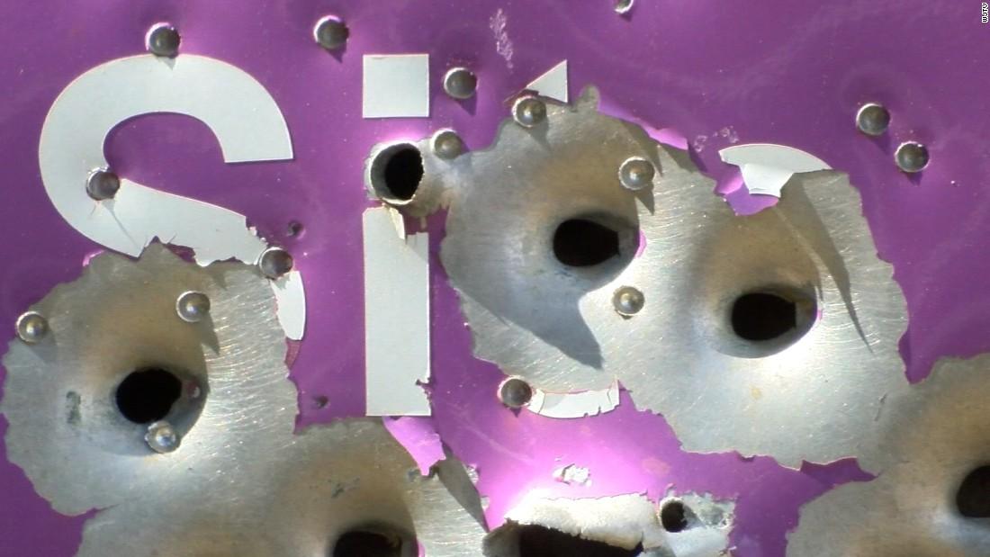 Emmett Till memorial sign scarred by bullet holes