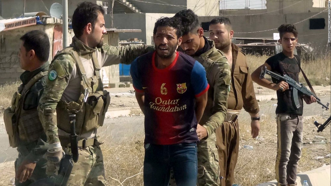 Kurdish security forces detain a suspected member of ISIS in the eastern suburbs of Kirkuk on Saturday, October 22.