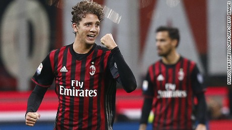 AC Milan's midfielder Manuel Locatelli celebrates after scoring against Juventus at the San Siro Stadium.