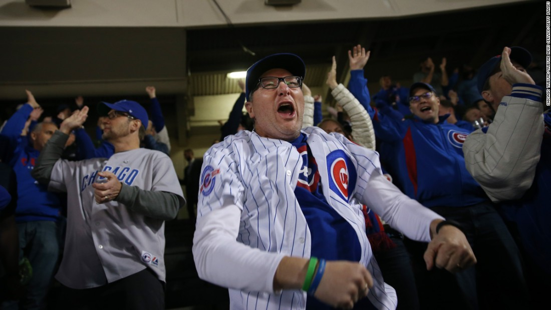 Chicago Cubs fan Jim Foste celebrates a Kris Bryant RBI single in the first inning against the Dodgers.
