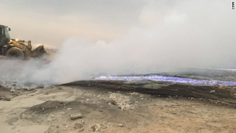 Smoke rises at the sulfur facility near Qayyara that was torched by ISIS militants.