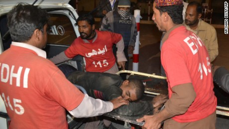 Pakistani volunteers rush an injured person to a hospital in Quetta, Pakistan, Monday, October 24, after two separate attacks in Pakistan.  Gunmen stormed a police training center in the restive southwestern province of Baluchistan Monday, leaving several people wounded, hours after another attack near to Quetta leaving two customs officers dead, authorities said.