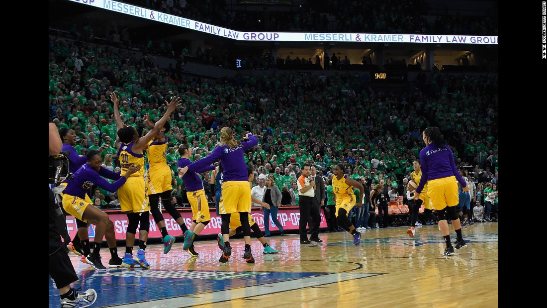 The Los Angeles Sparks celebrate after they won the WNBA title on Thursday, October 20. The Sparks defeated Minnesota 77-76 to win the best-of-five series 3-2. It is their first championship since 2002.