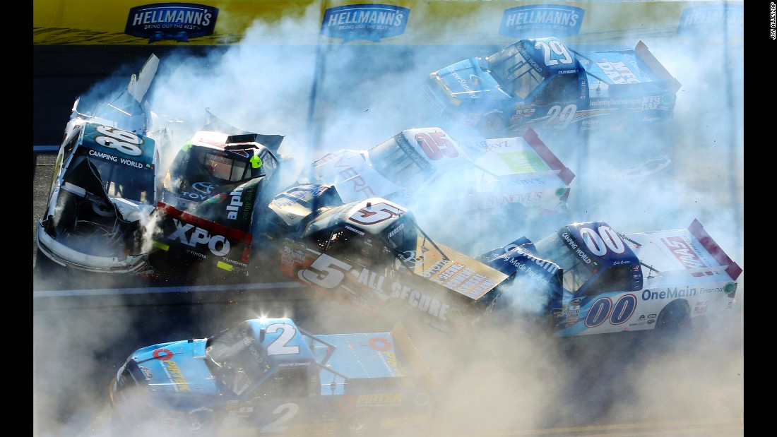 NASCAR trucks pile up during a wreck in Talladega, Alabama, on Saturday, October 22. No drivers were seriously hurt.