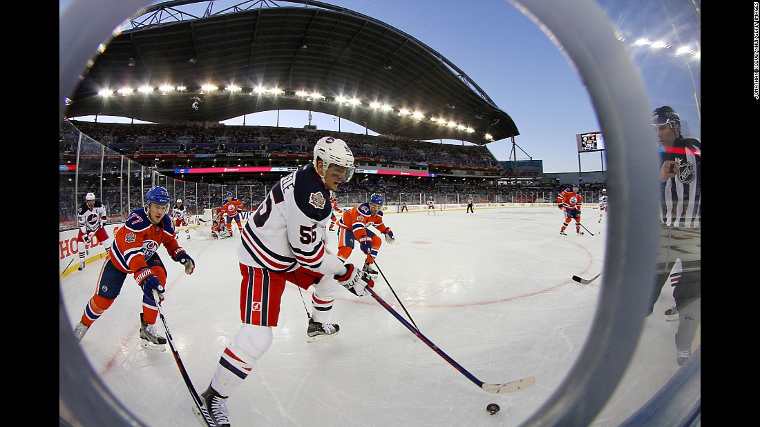 Winnipeg's Mark Schiefele plays the puck during the Heritage Classic, an NHL game played outdoors in Winnipeg, Manitoba, on Sunday, October 23.