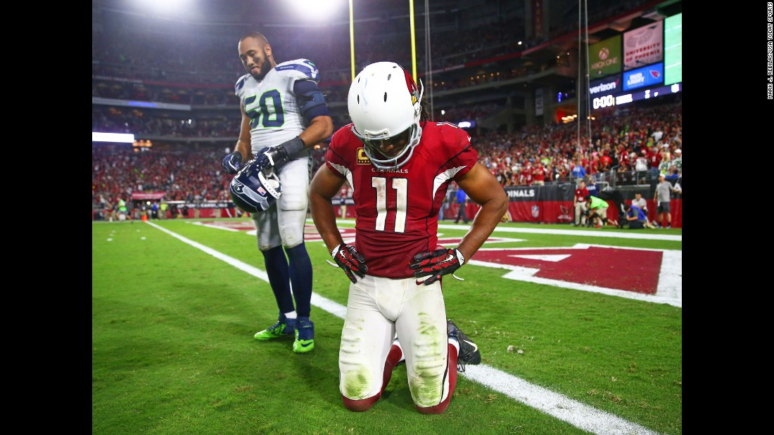 Seattle linebacker K.J. Wright, left, and Arizona wide receiver Larry Fitzgerald react after their teams tied 6-6 on Sunday, October 23. Both teams missed short field goals late in overtime.