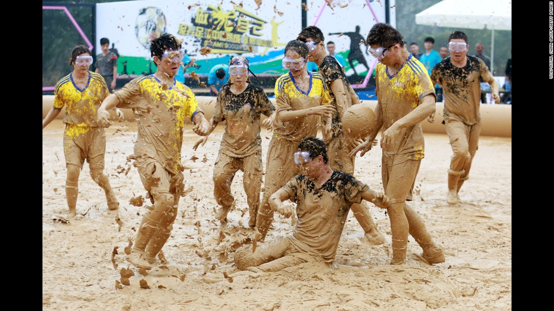 "People play in the mud Friday, October 21, during a ""swamp soccer"" tournament in Chengdu, China."