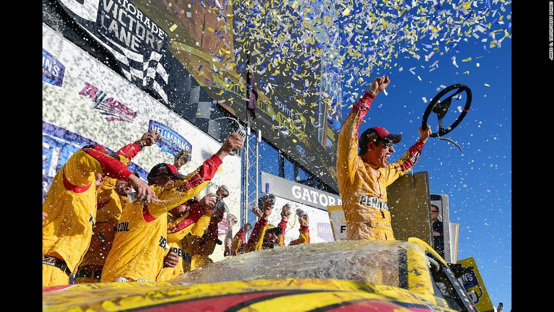 Joey Logano and his crew celebrate in Victory Lane after winning the NASCAR Sprint Cup race in Talladega, Alabama, on Sunday, October 23.