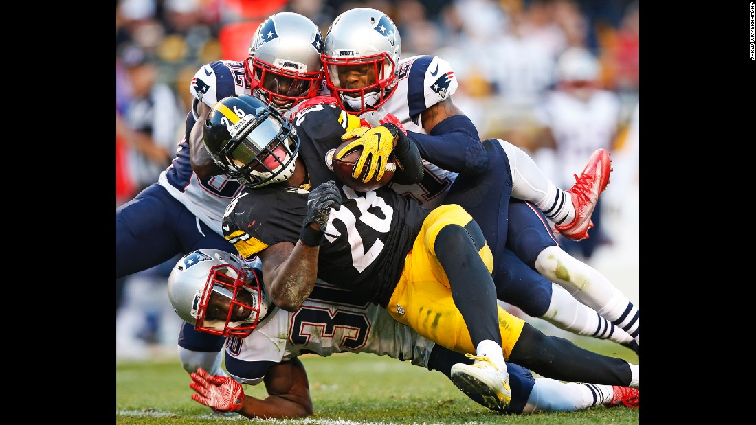 Pittsburgh running back Le'Veon Bell is tackled by New England Patriots during an NFL game in Pittsburgh on Sunday, October 23.