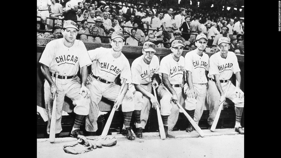 Chicago Cubs players pose outside of the dugout prior to game four.