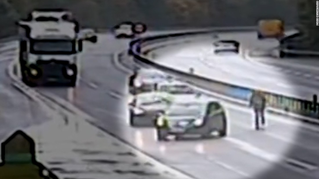 Man runs after car on busy highway