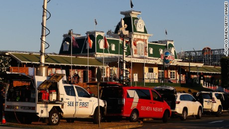 Emergency vehicles are seen in front of Dreamworld after a ride malfunctioned.