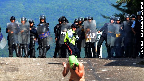 Riot police agents confront students opponent to Nicolas Maduro's government in San Cristobal, state of Tachira, Venezuela on October 24, 2016.