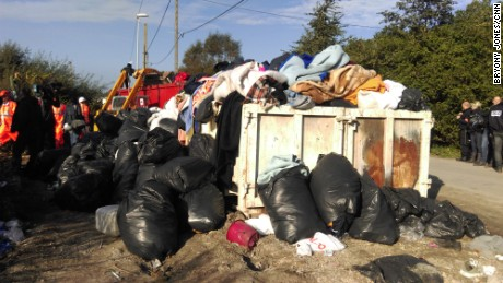 Dumpsters were filled with what migrants left behind -- mattresses, blankets and pillows.