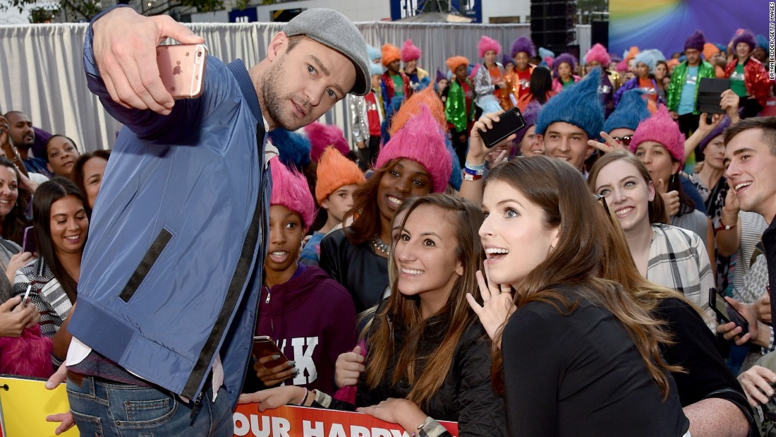 "Actors Justin Timberlake and Anna Kendrick pose with a fan in New York during a promotional event for their new film ""Trolls"" on Thursday, October 6."
