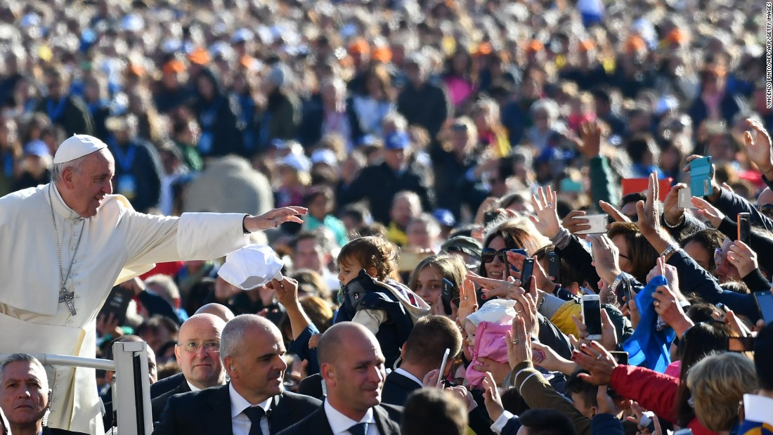 Pope Francis salutes the faithful upon his arrival in St. Peter's Square at the Vatican for the Special Jubilee Papal Audience on Saturday, October 22.