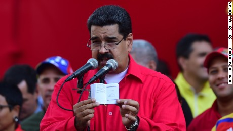 Venezuelan President Nicolas Maduro, who is resisting efforts by the opposition to remove him from power in a volatile political crisis, delivers a speech to supporters in Caracas on October 25, 2016. The opposition is planning nationwide street protests for Wednesday, the day it was to have begun collecting the four million signatures needed to trigger a recall referendum against Maduro but which electoral authorities blocked last week. / AFP / Ronaldo SCHEMIDT        (Photo credit should read RONALDO SCHEMIDT/AFP/Getty Images)