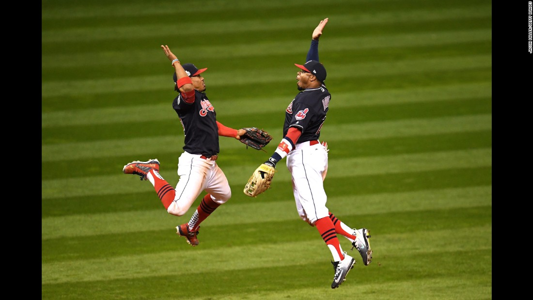 Francisco Lindor, left, and Rajai Davis of the Cleveland Indians celebrate after defeating the Chicago Cubs 6-0 in the Game 1.