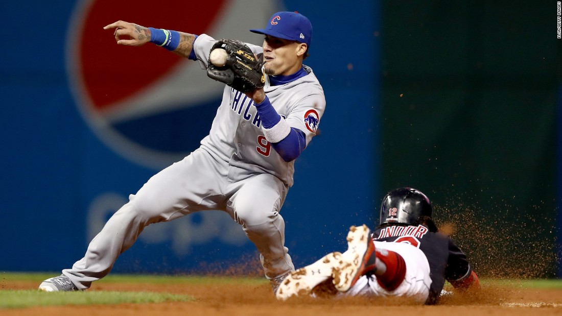 Javier Baez of the Cubs tags out Cleveland's Francisco Lindor as he tries to steal second base in Game 1.