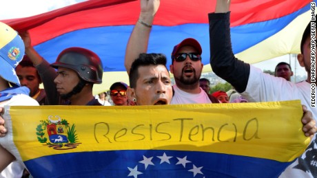 People demonstrate against the government of Venezuelan President Nicolas Maduro in Caracas on October 26, 2016.  Opponents of Maduro staged mass street rallies on Wednesday as he held a crisis security meeting, resisting their efforts to drive him from power. Tens of thousands of opposition supporters gathered at points around Caracas in the morning and joined up in the east of the capital while pro-government demonstrators gathered near the Miraflores presidential palace. / AFP / Federico PARRA        (Photo credit should read FEDERICO PARRA/AFP/Getty Images)