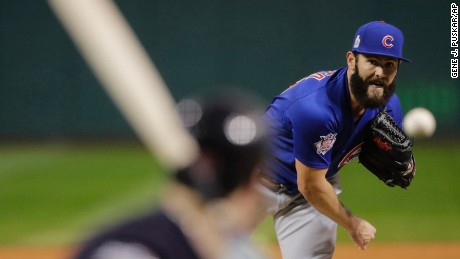 Chicago Cubs starting pitcher Jake Arrieta throws during the first inning of Game 2 .