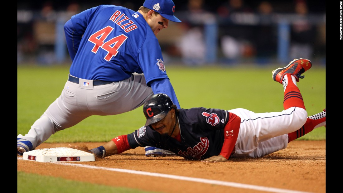 Francisco Lindor of the Indians dives back to first on an attempted pick-off in Game 2.