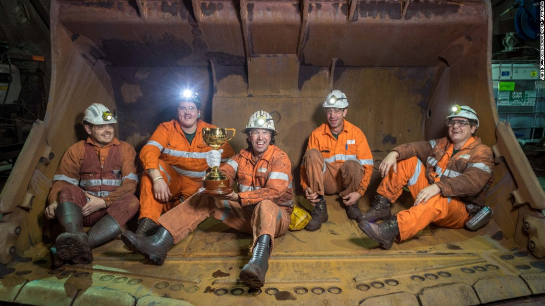Brian Connelly, Mick Williams, Nigel Shinnick, Angelo Dal Carrobbo and James Hooper pose with the trophy at BHP Billiton's Olympic Dam copper, gold and uranium mine in Roxby Downs, South Australia.