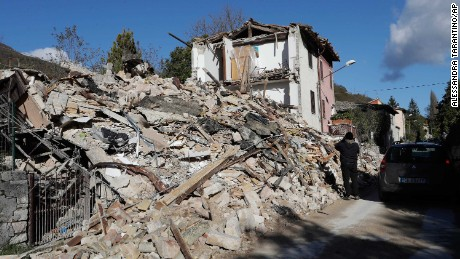 A house was completely destroyed in the small town of Visso in central Italy, Thursday, Oct 27, 2016, after a 5.9 earthquake destroyed part of the town. A pair of strong aftershocks shook central Italy late Wednesday, crumbling churches and buildings, knocking out power and sending panicked residents into the rain-drenched streets just two months after a powerful earthquake killed nearly 300 people. (AP Photo/Alessandra Tarantino)