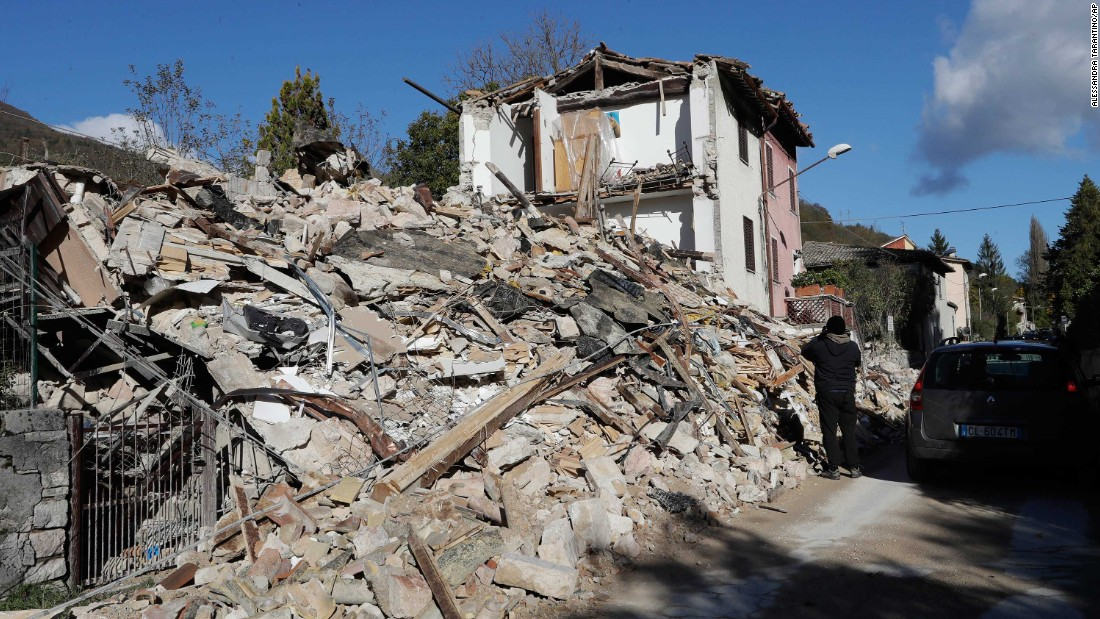 A house lies in ruins in Visso on October 27.
