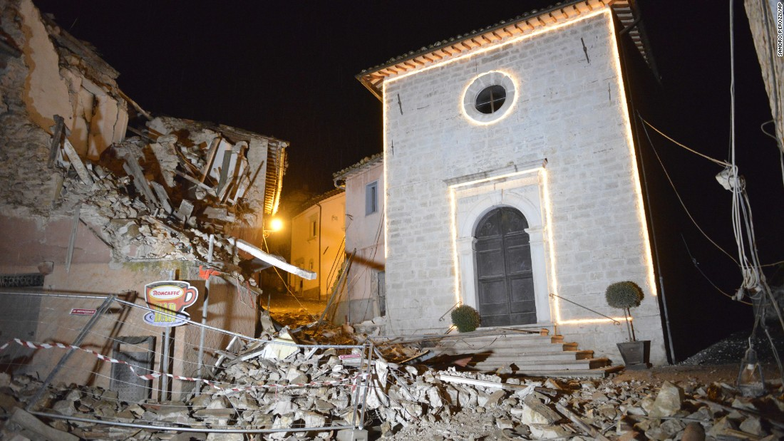The Church of San Sebastiano stands amid damaged houses in Castelsantangelo sul Nera on October 26.