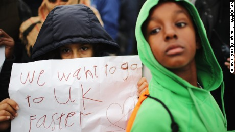 Children protest their case to the UK government at the now-demolished Jungle camp in Calais in October 2016.