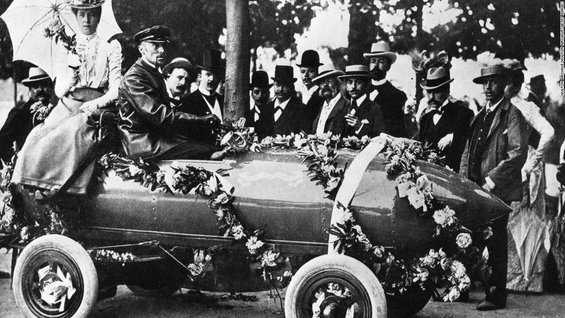 "Camille Jenatzy was the first man to exceed 100 kph (62 mph) at Acheres, near Paris in 1899 in an electric car, christened ""La Jamais Contente."""
