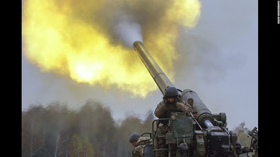 Ukrainian troops fire artillery during a military exercise in Devichki, Ukraine, on Friday, October 21.