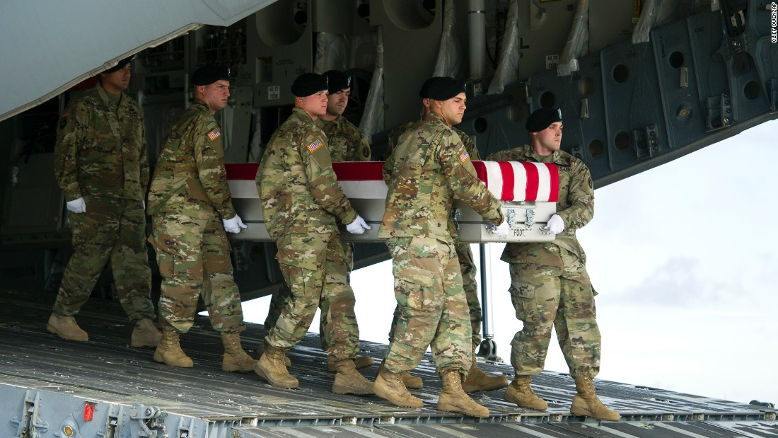 The body of U.S. Army Sgt. Douglas Riney is carried off a plane at an Air Force base in Dover, Delaware, on Friday, October 21. Riney, a 26-year-old from Fairview, Illinois, was killed in Afghanistan.