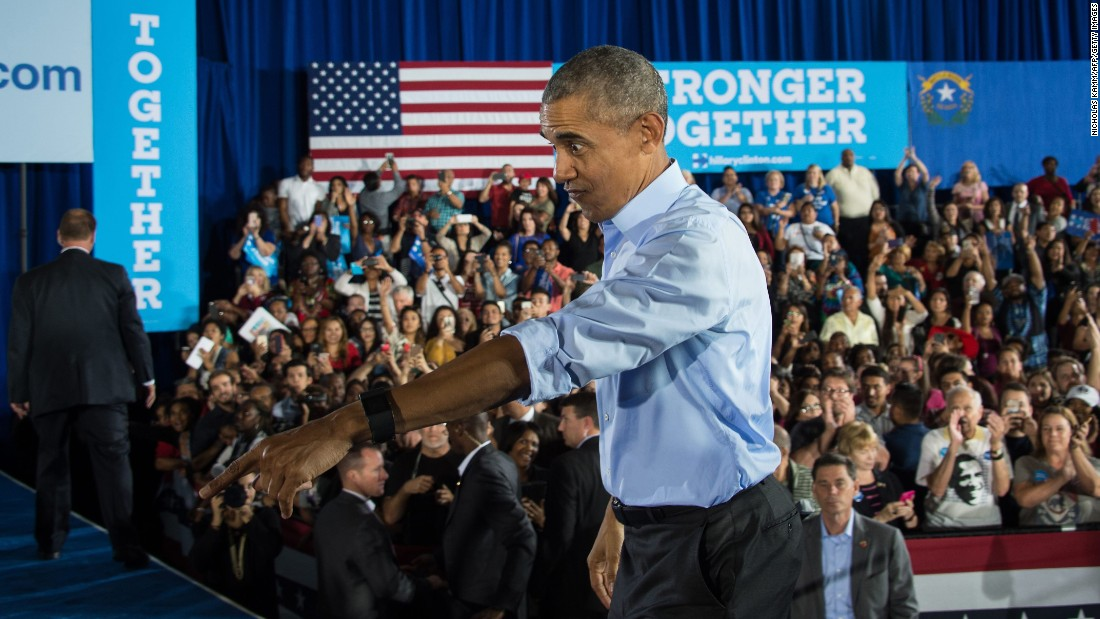 U.S. President Barack Obama walks back to the stage in Las Vegas after shaking hands at a Hillary Clinton campaign rally on Sunday, October 23.
