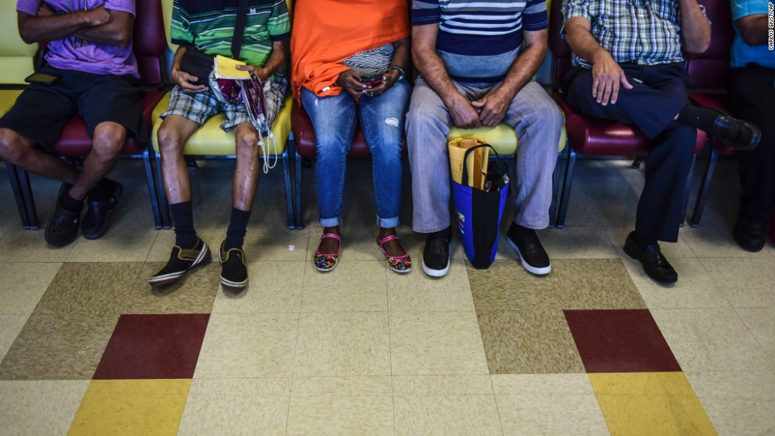 "Patients wait at a medical clinic in San Juan, Puerto Rico, on Monday, October 24. Puerto Rico's economic crisis <a href=""http://money.cnn.com/2016/04/13/investing/puerto-rico-debt-medicare/"" target=""_blank"">has left the island with fewer doctors.</a>"