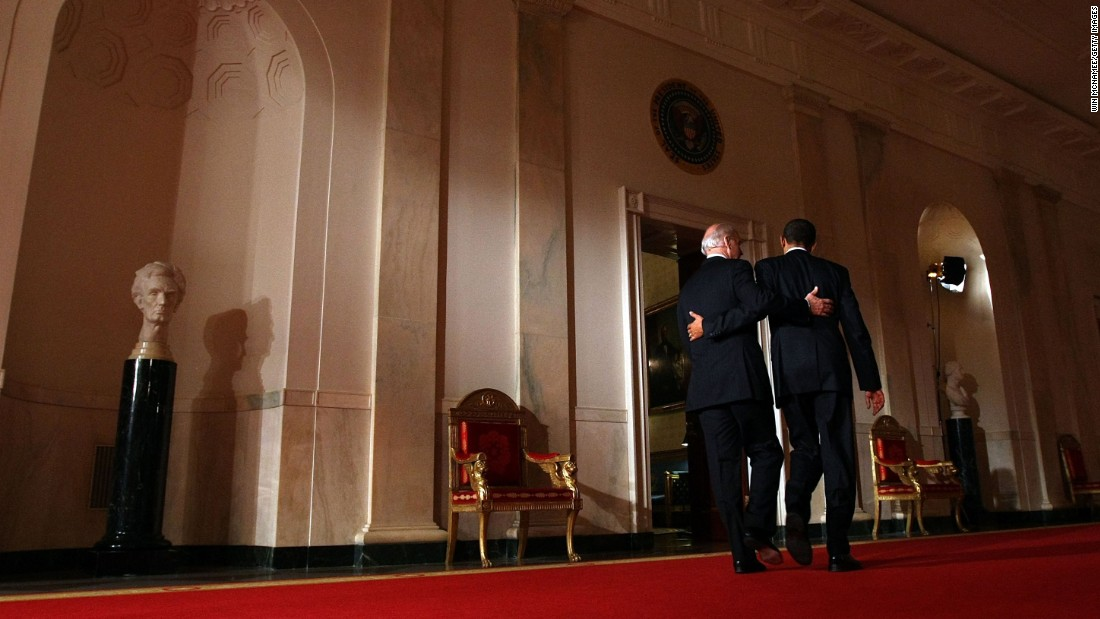 "Biden and President Barack Obama put their arms around each other after Obama's <a href=""http://www.cnn.com/2010/POLITICS/03/23/health.care.main/"" target=""_blank"">health care overhaul</a> was passed in March 2009. It was the biggest expansion of health care guarantees in more than four decades, and it represented a significant step toward the goal of universal coverage, which had been sought by every Democratic President since Harry Truman."