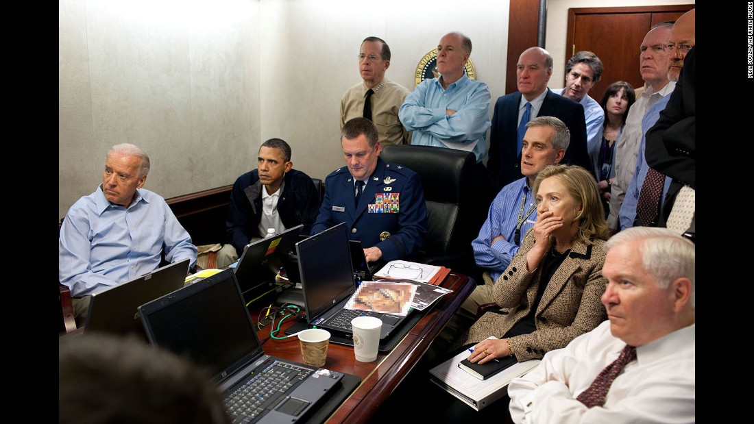 "Biden sits with Obama and members of Obama's national security team as they monitor <a href=""http://www.cnn.com/2016/04/30/politics/obama-osama-bin-laden-raid-situation-room/"" target=""_blank"">the mission against Osama bin Laden</a> in May 2011. (Editor's note: The classified document in front of Hillary Clinton was obscured by the White House.)"