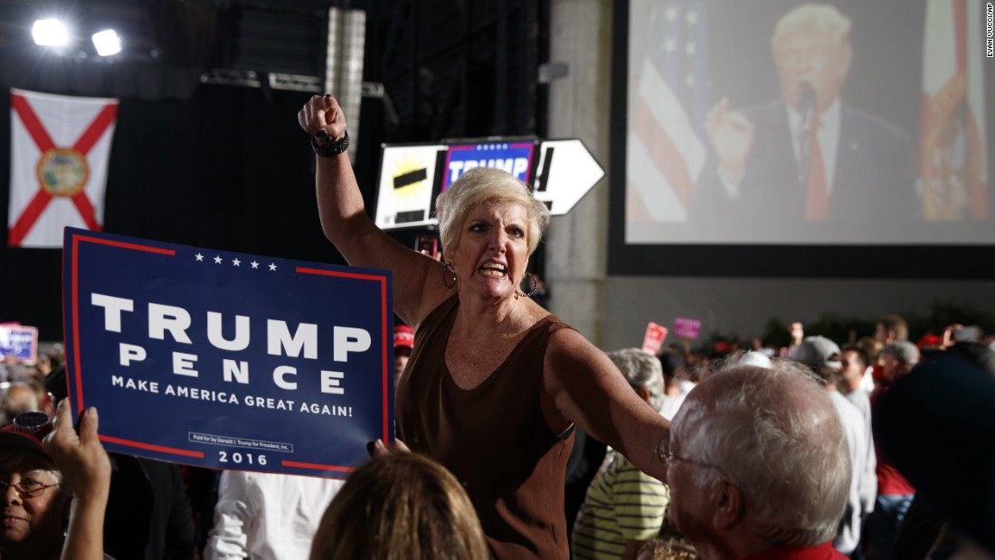 While attending a Donald Trump campaign rally, supporter Donna Decker screams at reporters in Tampa, Florida, on Monday, October 24.