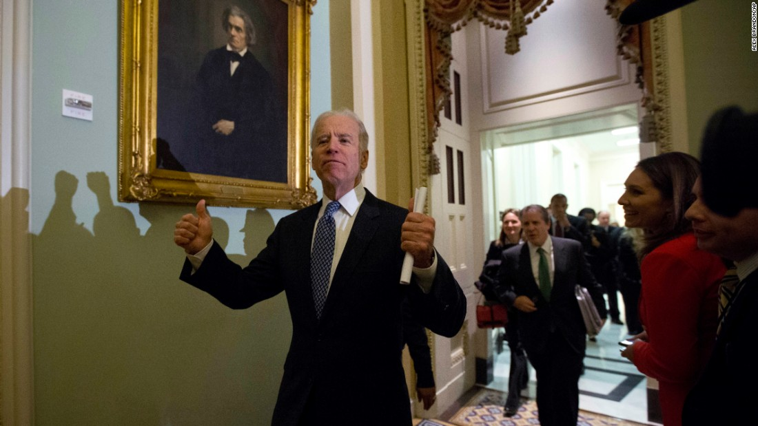 "Biden gives two thumbs up after a meeting with Senate Democrats in December 2012. Congress <a href=""http://www.cnn.com/2013/01/01/politics/fiscal-cliff/"" target=""_blank"">eventually agreed to a budget deal</a> to avoid automatic tax increases on January 1, 2013."