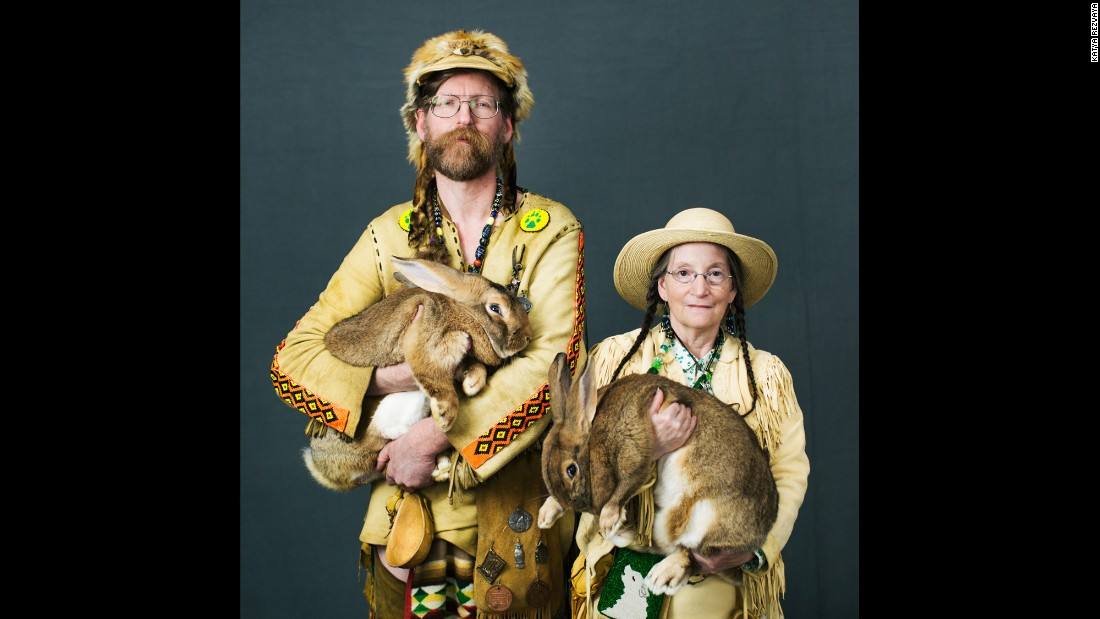 Daniel and Susan Hathaway, of Bandon, Oregon, hold their rabbits Defiance and Enterprise. The rabbits are Flemish Giants, one of the largest rabbit breeds.