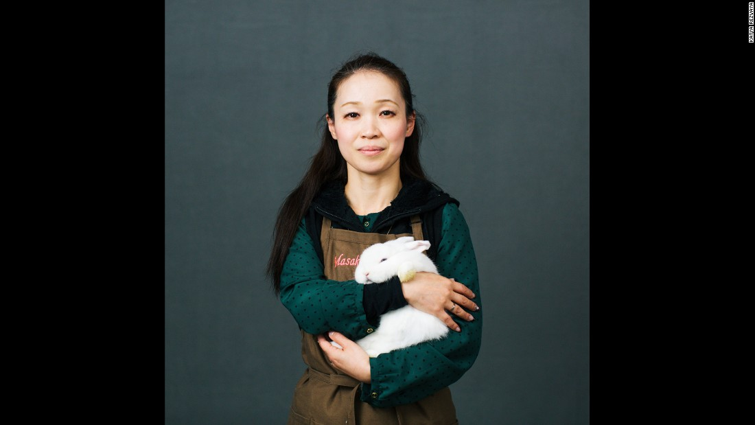 Masako Miyazaki is from Japan. She is holding Sarah, a 4-month-old Holland Lop rabbit. She told Rezvaya she had about 100 rabbits of five different breeds.