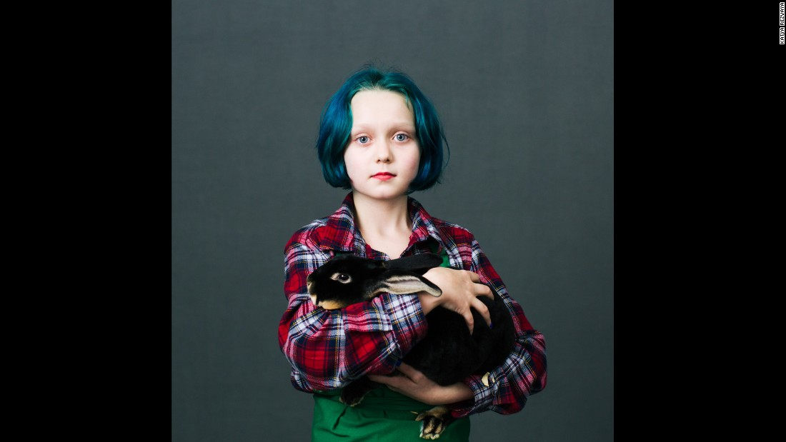 Virginia Anderson, a 10-year-old from Dallas, Oregon, holds Romeo, a Black Otter Rex rabbit.