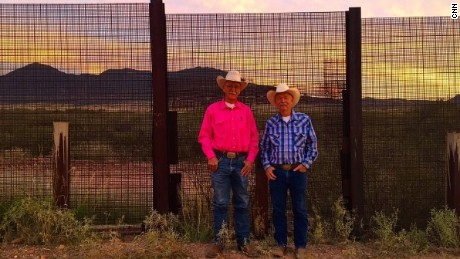 Fred Davis and John Ladd at the U.S.-Mexico border on Ladd's ranch.