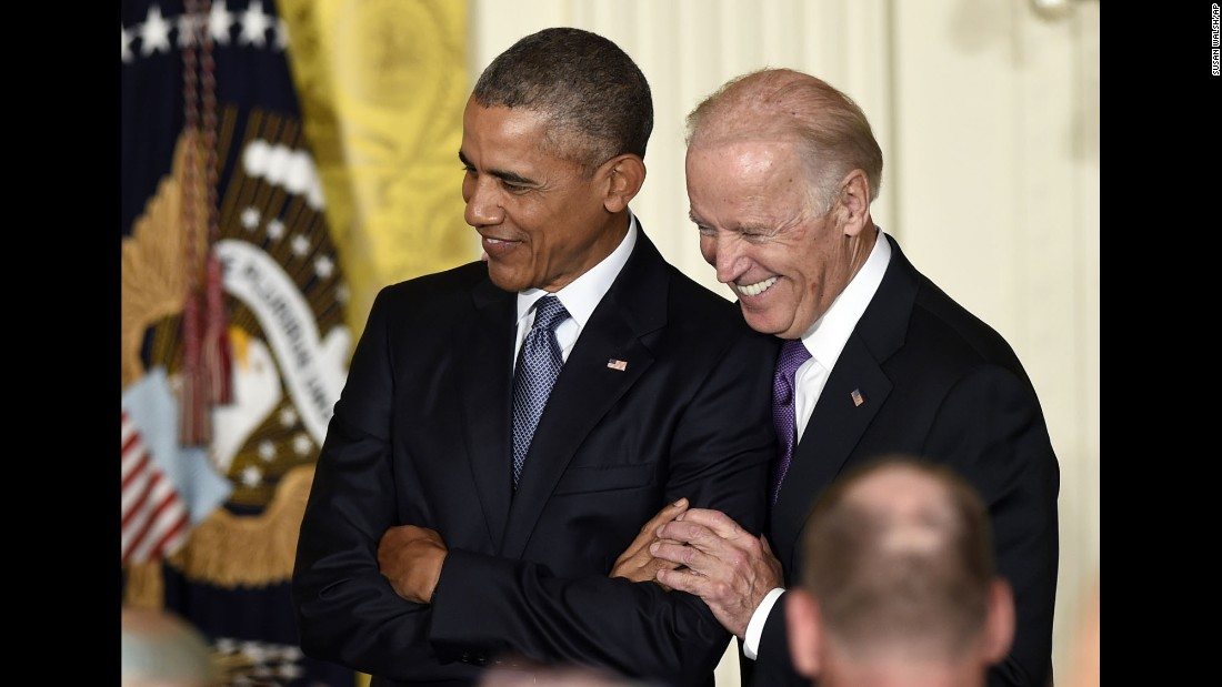 Biden and Obama share a light moment at the White House, where Obama spoke at a reception honoring Hispanic Heritage Month in October 2015.