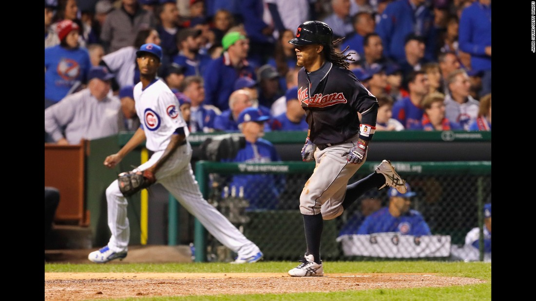 Michael Martinez of the Cleveland Indians scores a run during the seventh inning in Game 3.